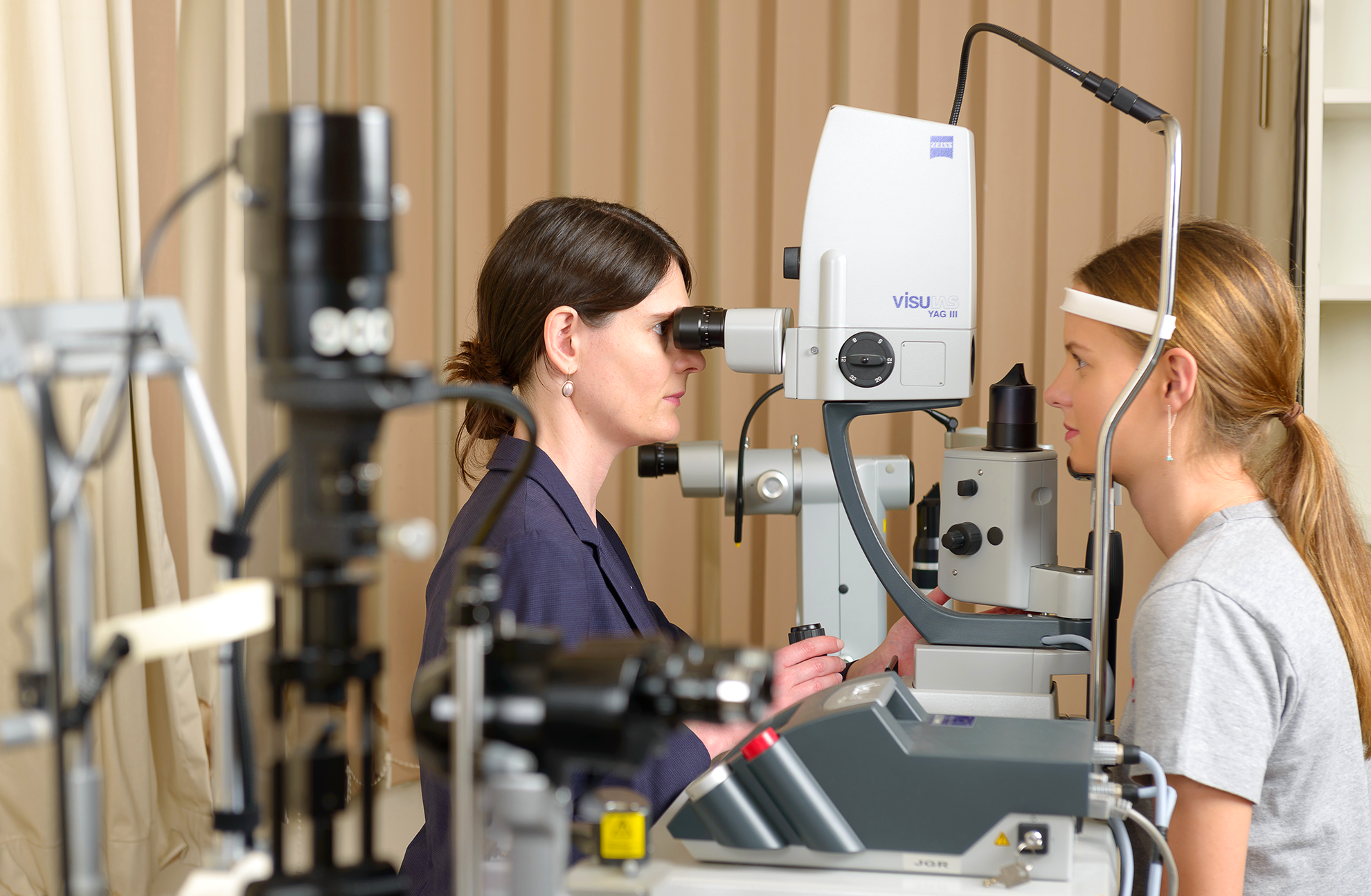 Dr Gregory-Roberts examining a patients eye at Eye Specialist Practice Bondi Junction